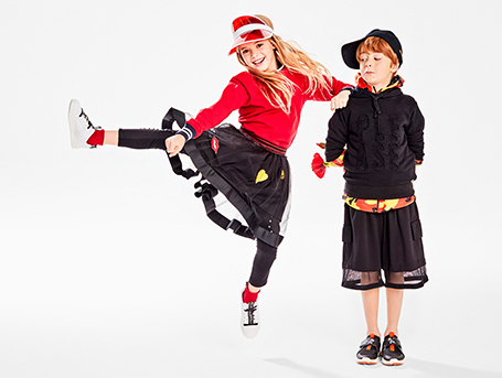 A girl and boy pose in her Geox DJ Rock & Flexyper sneakers.
