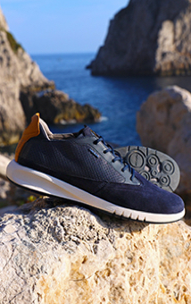 7cbe4e3056 The Geox Aerantis is a navy leather sneaker for men with enhanced  breathability.